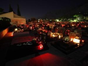A graveyard on All Saints night.